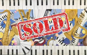 instruments and piano keys with sold stamp