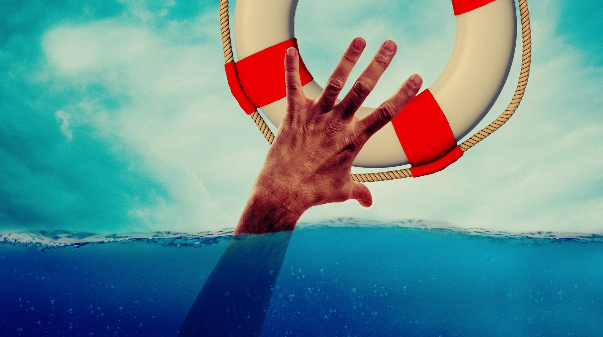 man grabbing a lifesaver ring