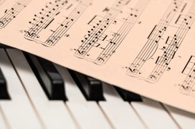 sheet music and piano keys