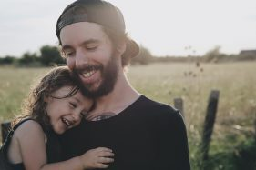 smiling dad and daughter